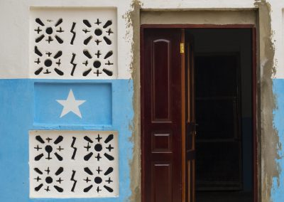 Painted Somali flag on doorway in Baidoa